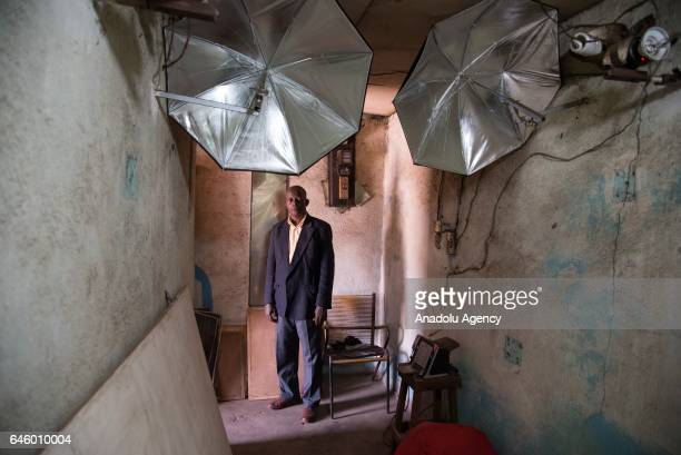 Daouda Coulibaly poses inside his photo studio, which was founded in 1981, at Mamadou Konate Avenue in the Coura region of Bamako, Mali on February...