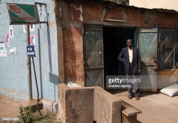 Daouda Coulibaly poses outside his photo studio, which was founded in 1981, at Mamadou Konate Avenue in the Coura region of Bamako, Mali on February...