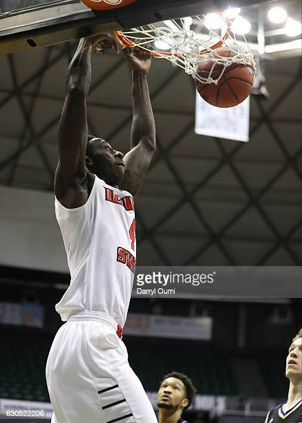 Daouda Ndiaye of the Illinois State Redbirds dunks the ball during the first half of the Diamond Head Classic third place game against the Tulsa...