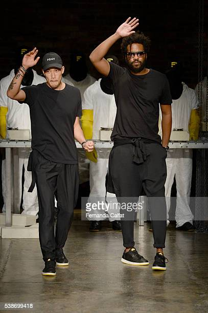 DaoYi Chow and Maxewell Osborne walk at Public School's Women's And Men's Spring 2017 Runway Show at Cedar Lake on June 7 2016 in New York City