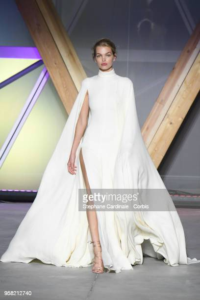 Daphne Groeneveld walks the runway at Fashion For Relief Cannes 2018 during the 71st annual Cannes Film Festival at Aeroport Cannes Mandelieu on May...