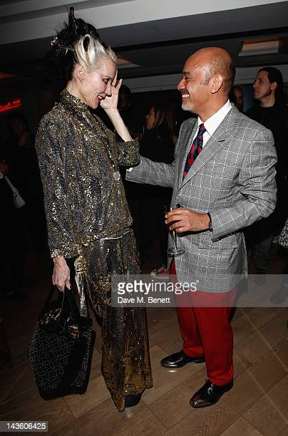 Daphne Guinness and Christian Louboutin attend as French shoe designer Christian Louboutin celebrates the opening of his exhibition at the Design...