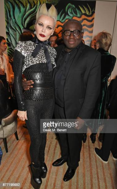 Daphne Guinness and Edward Enninful attend Louis Vuittons Celebration of GingerNutz in Vogue's December Issue on November 21 2017 in London England