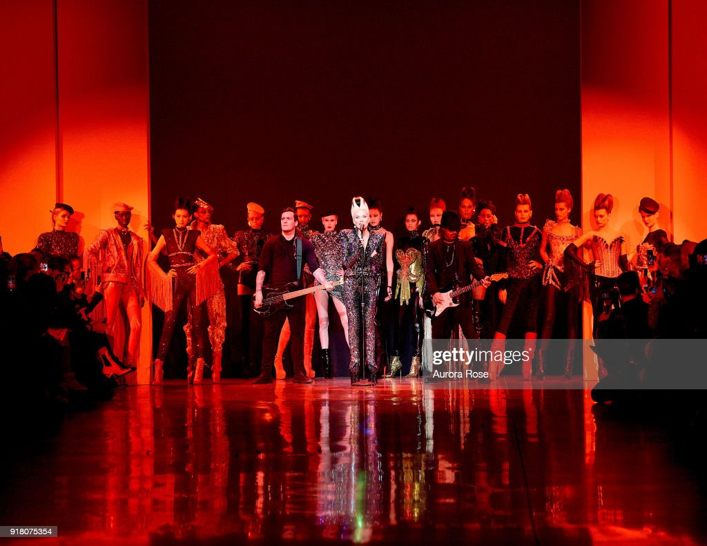 Daphne Guinness closes The Blonds Runway by singing with a band at Spring Studios on February 13, 2018 in New York City.