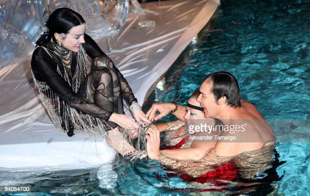 Daphne Guinness, make-up artist/model Sharon Gault and photographer David LaChapelle swim in the pool during the Maybach presents David LaChapelle's...