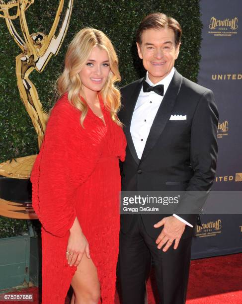 Daphne Oz and Dr Mehmet Oz arrive at the 44th Annual Daytime Emmy Awards at Pasadena Civic Auditorium on April 30 2017 in Pasadena California