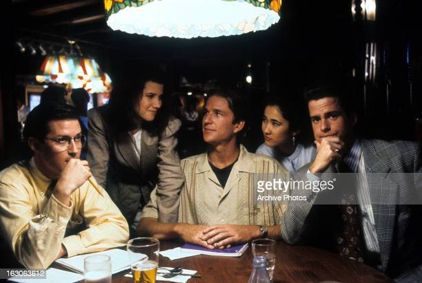 Daphne Zuniga meets up with Matthew Modine and his friends at a bar in a scene from the film 'Gross Anatomy' 1989