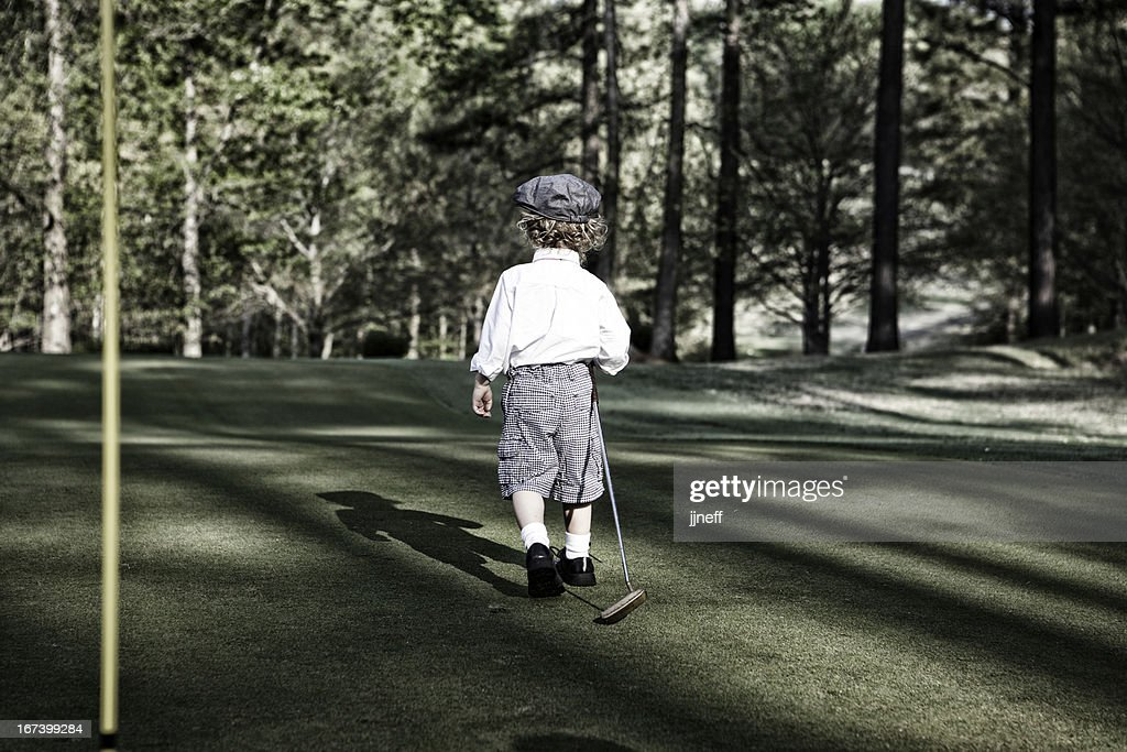 Dapper Boy Playing Golf : Stockfoto