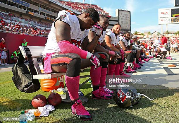 Da'Quan Bowers of the Tampa Bay Buccaneers holds his head during a game against the Philadelphia Eagles at Raymond James Stadium on October 13 2013...
