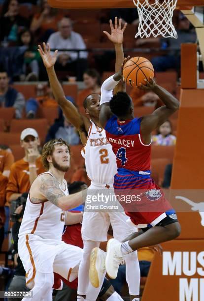 DaQuan Bracey of the Louisiana Tech Bulldogs shoots the ball against Matt Coleman of the Texas Longhorns at the Frank Erwin Center on December 16...
