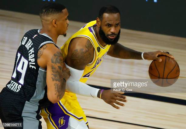 DaQuan Jeffries of the Sacramento Kings defends against LeBron James of the Los Angeles Lakers during the second quarter at The Field House at ESPN...