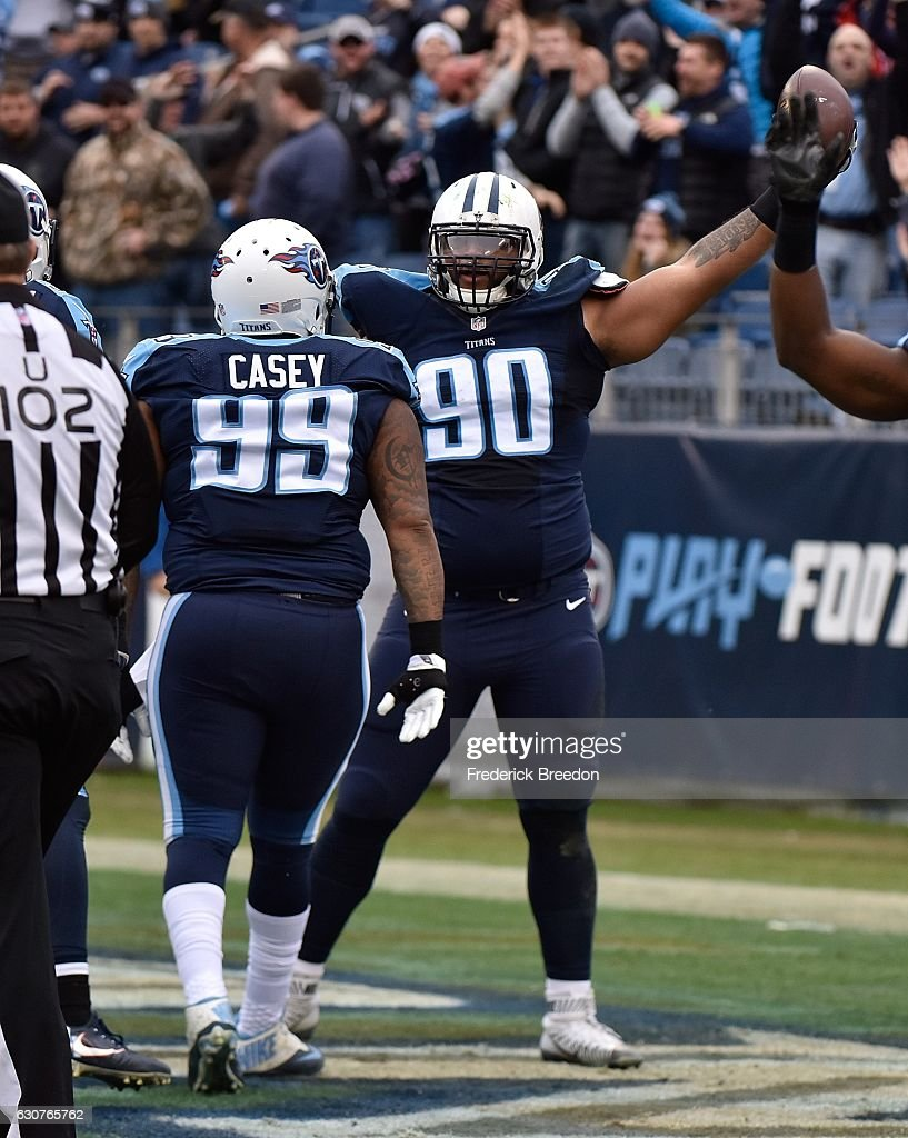 DaQuan Jones #90 of the Tennessee Titans celebrates after scoring a touchdown against the Houston Texans during the first half at Nissan Stadium on January 1, 2017 in Nashville, Tennessee.