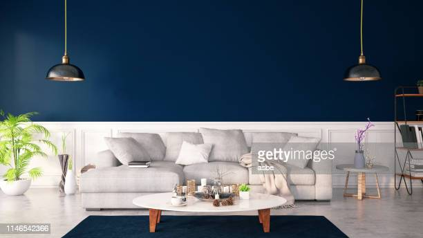 dar blue color interior with sofa - electric lamp stock pictures, royalty-free photos & images