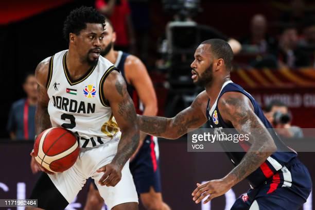 Dar Tucker of Jordan drives the ball against Amath M'Baye of France during FIBA World Cup 2019 Group G match between Jordan and France at Shenzhen...