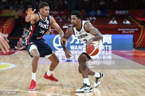 Dar Tucker of Jordan drives the ball against Axel Toupane of France during FIBA World Cup 2019 Group G match between Jordan and France at Shenzhen...