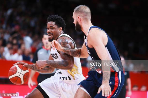 Dar Tucker of Jordan drives the ball against Evan Fournier of France during FIBA World Cup 2019 Group G match between Jordan and France at Shenzhen...