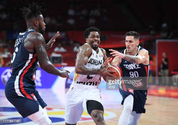 Dar Tucker of Jordan goes to the basket against Paul Lacombe of France during FIBA World Cup 2019 Group G match between Jordan and France at Shenzhen...