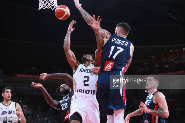 Dar Tucker of Jordan goes to the basket against Vincent Poirier of France during FIBA World Cup 2019 Group G match between Jordan and France at...