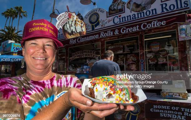 Dara Baldwin owner of DD Country Fair Cinnamon Rolls holds the Unicorn Roll at the San Diego County Fair in Del Mar on Wednesday June 27 2018 DD...