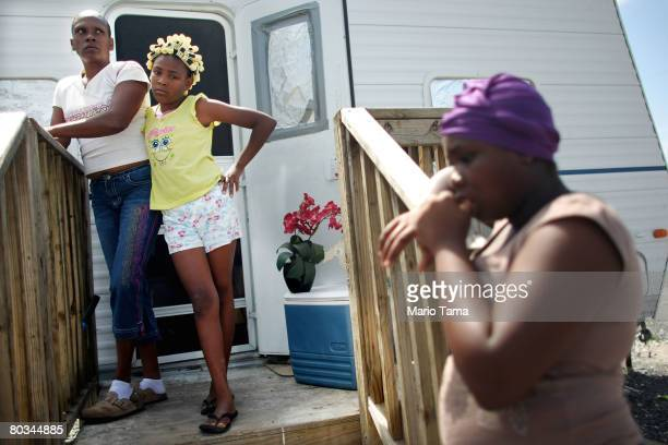 Dara Barthelemy stands with her daughters Temika St Ann and Jasmine outside the FEMA trailer they live in with three other family members in the FEMA...