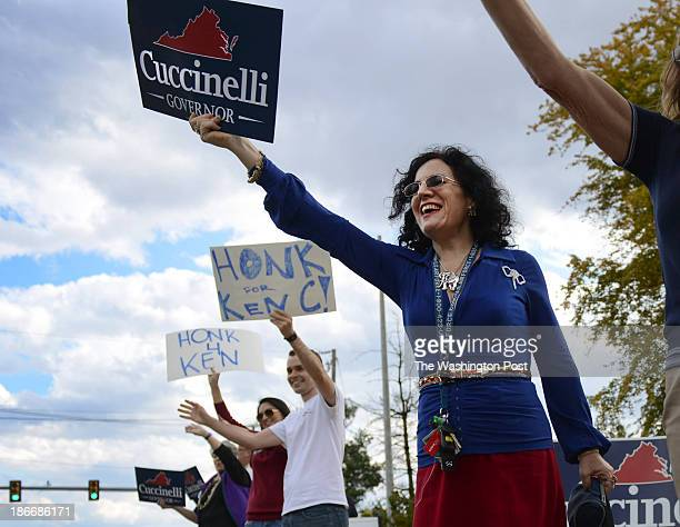 Dara Fox campaigns roadside for Virginia Gubernatorial candidate Ken Cuccinelli prior to a campaign rally in Woodbridge Virginia on November 2 2013...