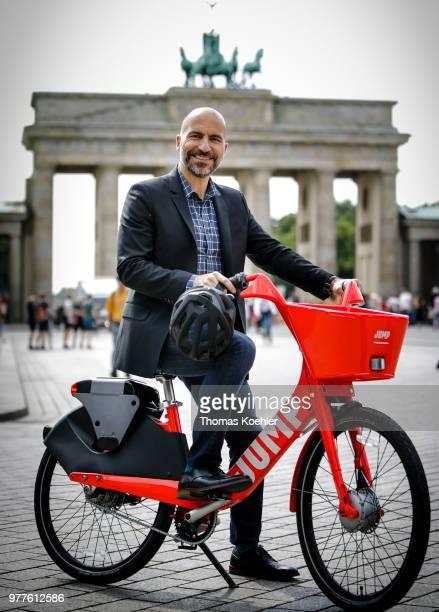 Dara Khosrowshahi CEO Uber presents the Jump electric bike sharing service at the Brandenburg Gate on June 5 2018 in Berlin Germany