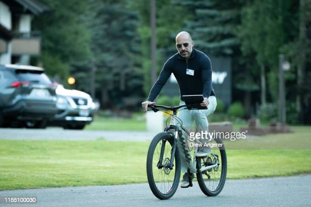 Dara Khosrowshahi chief executive officer of Uber rides a bike as he attends the annual Allen Company Sun Valley Conference July 11 2019 in Sun...