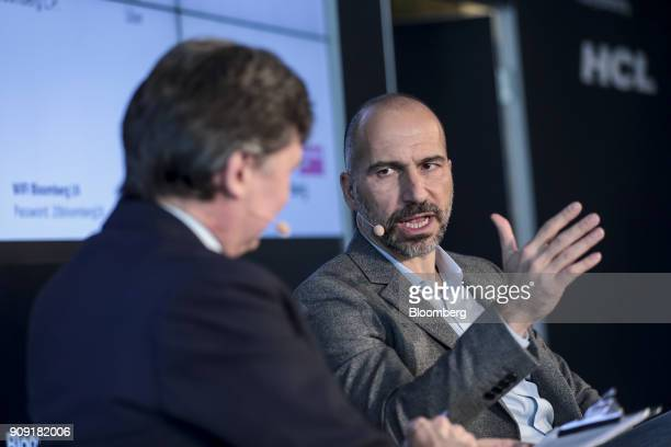 Dara Khosrowshahi chief executive officer of Uber Technologies Inc right speaks with John Micklethwait editorinchief of Bloomberg News during an...