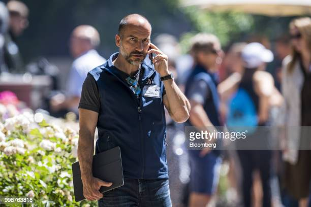 Dara Khosrowshahi chief executive officer of Uber Technologies Inc speaks on the phone after the morning session at the Allen Co Media and Technology...