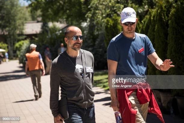 Dara Khosrowshahi chief executive officer of Uber walks with Ian Smith managing director at Allen Company as they attend annual Allen Company Sun...