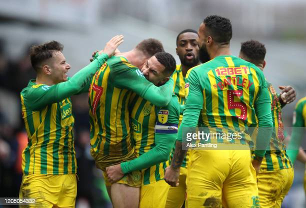 Dara O'Shea of West Bromwich Albion celebrates with his team mates after scoring his team's second goal during the Sky Bet Championship match between...