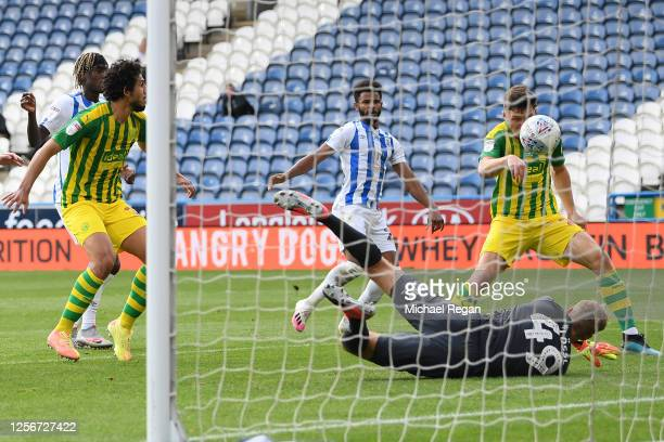 Dara O'Shea of West Bromwich Albion scores his team's first goal past Jonas Loessl of Huddersfield Town during the Sky Bet Championship match between...