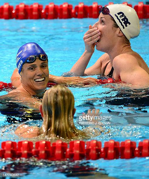 Dara Torres who finished in fourth place turns to winner Jessica Hardy as Kara Lynn Joyce reacts to her second place finish in the women's 50M...