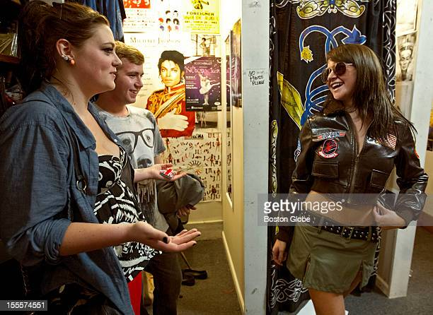 Darby Rose models a Top Gun costume for her friends Caitlin Maytnard's left and Travis Sweeney at Dorothy's Costume Boutique Rose is shopping for a...
