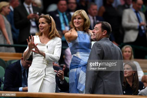 Darcey Bussell and Fiona Bruce in discussion with AELTC Chairman Philip Brook in the centre court royal box on day eight of the Wimbledon Lawn Tennis...