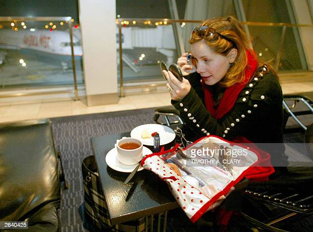 Darcey Bussell leading ballerina with the Royal Ballet puts on her makeup as she waits in the departure area before boarding at John F Kennedy...
