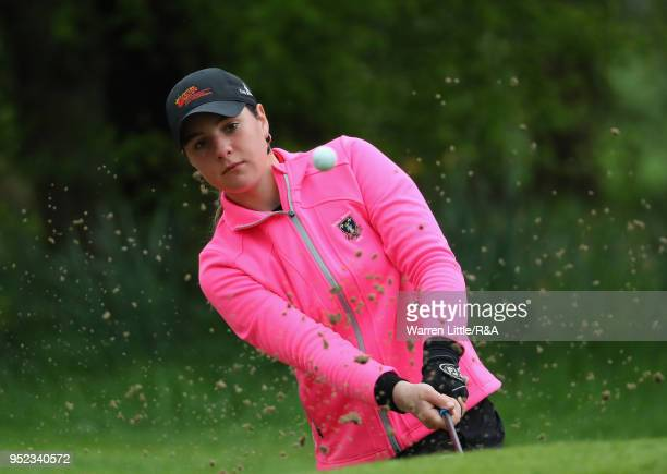 Darcey Harry plays out of the fourth greenside bunker during the second round of the Girls' U16 Open Championship at Fulford Golf Club on April 28...