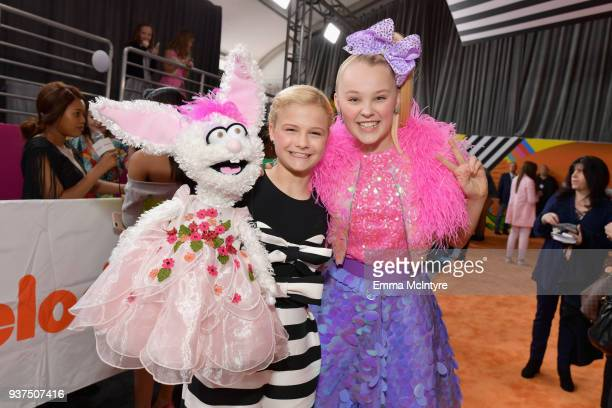 Darci Lynne Farmer and JoJo Siwa attend Nickelodeon's 2018 Kids' Choice Awards at The Forum on March 24 2018 in Inglewood California