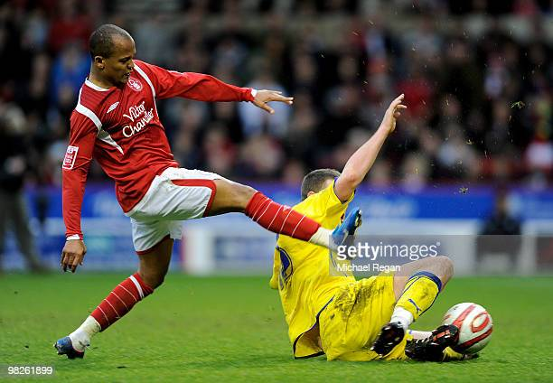 Darcy Blake of Cardiff blocks a shot from Robert Earnshaw of Nottingham Forest during the Coca Cola Championship match between Nottingham Forest and...