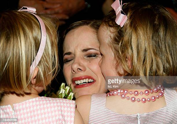 Darcy Bussell hugging her two daughters Zoe and Phoebe after her final curtain call for her last performance 'Song of the Earth' at the Royal Opera...
