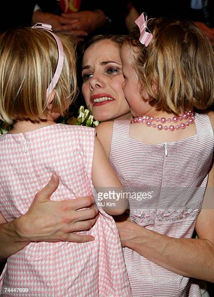 Darcy Bussell hugs her two daughters Phoebe and Zoe after her final curtain call for her last performance 'Song of the Earth' at the Royal Opera...