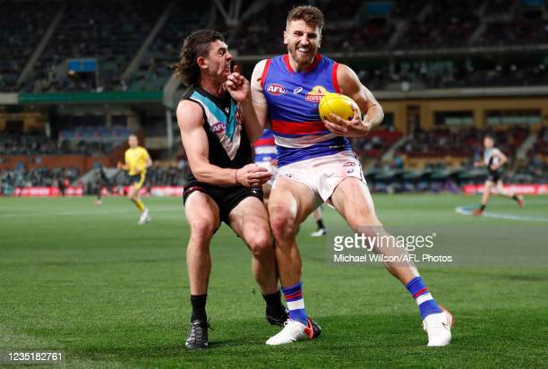 Darcy Byrne-Jones of the Power and Marcus Bontempelli of the Bulldogs in action during the 2021 AFL Second Preliminary Final match between the Port...