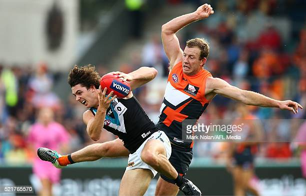 Darcy ByrneJones of the Power and Steve Johnson of the Giants contest a mark during the round four AFL match between the Greater Western Sydney...