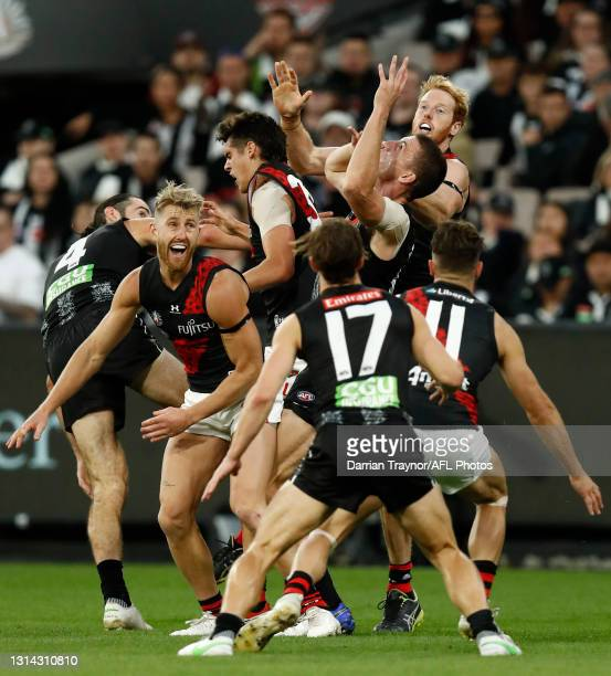 Darcy Cameron of the Magpies and Andrew Phillips of Essendon compete during the round six AFL match between the Collingwood Magpies and the Essendon...