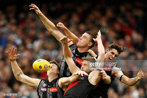Darcy Cameron of the Magpies attempts to mark the ball over team mate Brody Mihocek and Jayden Laverde of Bombers during the round six AFL match...
