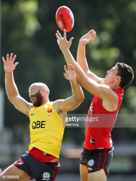 Darcy Cameron of the Swans is challenged by Jarrad McVeigh of the Swans during the Sydney Swans AFL pre-season training session at Lakeside Oval on...