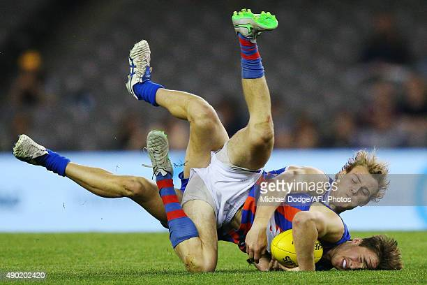 Darcy Crocker of the Ranges tackles Tom Phillips of the Chargers during the TAC Cup Grand Final match between the Eastern Ranges and the Oakleigh...