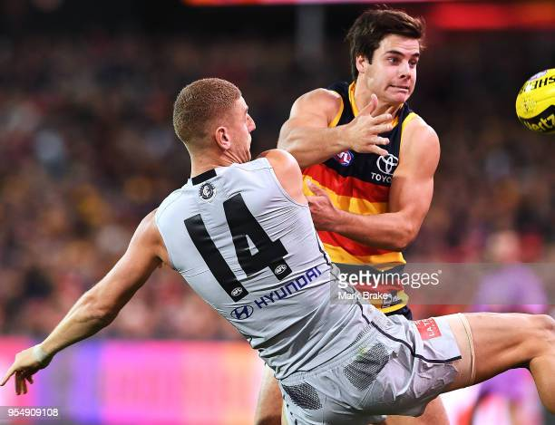 Darcy Fogarty of the Adelaide Crows and Liam Jones of the Blues during the round seven AFL match between the Adelaide Crows and the Carlton Blues at...