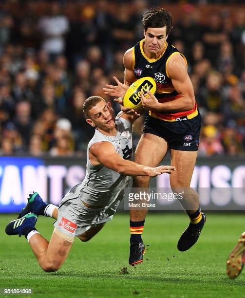 Darcy Fogarty of the Adelaide Crows marks in front of Liam Jones of the Blues during the round seven AFL match between the Adelaide Crows and the...