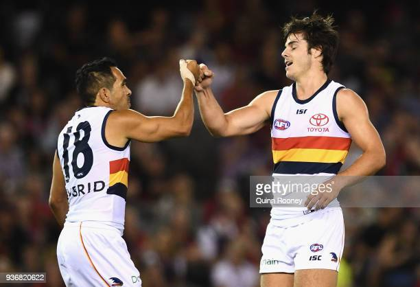 Darcy Fogarty of the Crows is congratulated by Eddie Betts after kicking a goal during the round one AFL match between the Essendon Bombers and the...